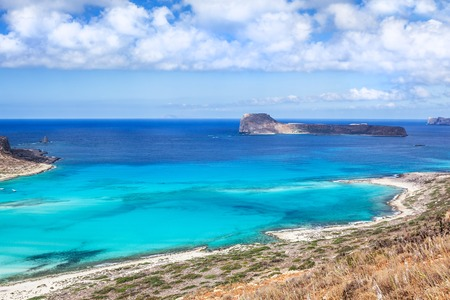 Picturesque view on Balos bay, Gramvousa island and sea lagoon with clear limpid turquoise water on a bright sunny day looks like a paradise. Crete, Greece. Imagens