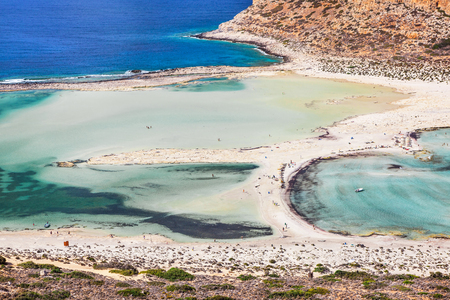 Beautiful sea lagoon with clear azure water on a bright sunny day looks like a dream. Balos bay on Crete island, Greece.