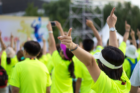 participate: energetic girl raises her hand and participate in an activity