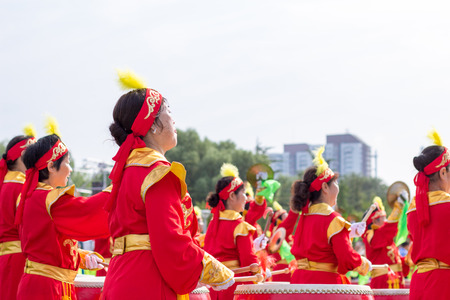 beat women: women are dressed in traditional red clothing to participate in traditional activities Editorial