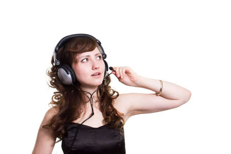 girl with a curly hair in earphones on a white background photo