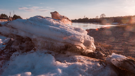 the ice floes cast by a current ashore in the spring in April during an ice drift