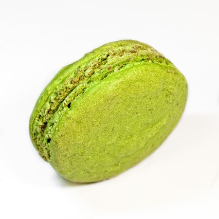 colorful macaroon pistachio cookies on white background