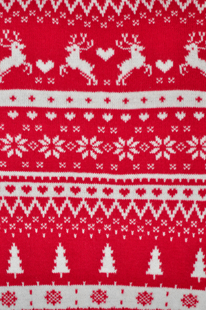 Element decor Christmas red knitted sweater close-up. Holiday gift.