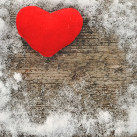 Valentine's day and Love composition with red plush heart on wooden background in snow. Healthy lifestyle concept. top view. copy spase.square Stock Photo