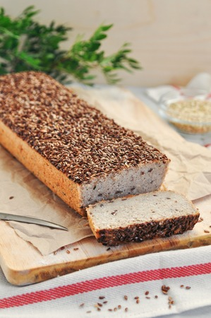 Useful home-made vegan sourdough bread from green buckwheat with flax and sunflower seeds. Raw healthy and proper nutrition.