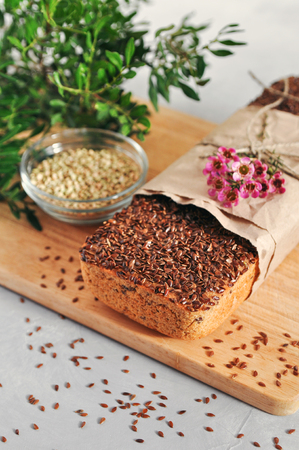 Useful home-made vegan sourdough bread from green buckwheat with flax and sunflower seeds. Raw healthy and proper nutrition