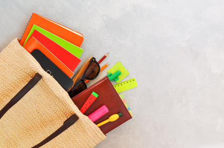 Stylish fashionable wicker bag with tablet, notebooks and pens in the form of pineapple, watermelon, cactus and other stationery and sunglasses. Admission to University and summer session, exams