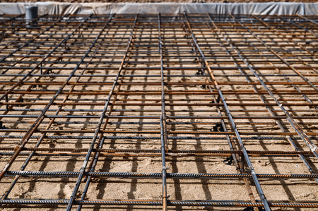 Reinforced Foundation for pouring concrete in the construction of a house on a plot of land