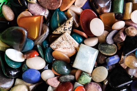 cabochon: a pile of multicolor stones and minerals, cabochon at the market in India Stock Photo