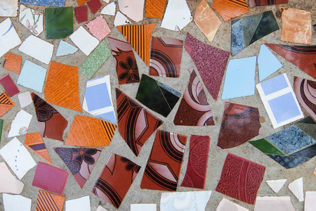 diagonals: surface of broken ceramic tiles with cement