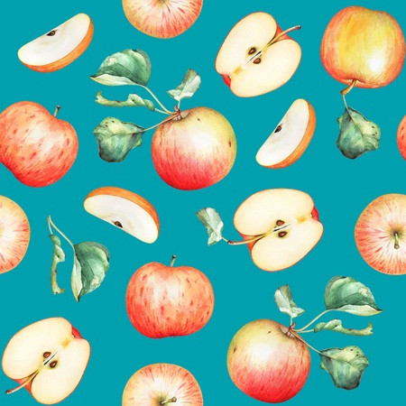 Red apples with green leaves on bright blue background
