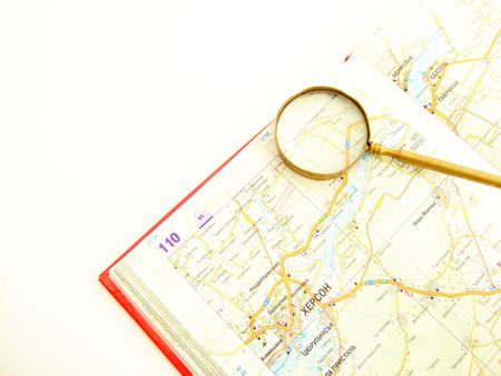 kilometre: Magnifying glasses and atlas Stock Photo