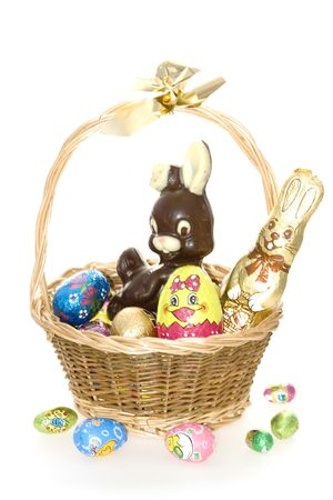 bunnie: Easter Bunny Sitting in a Basket with Decorated Eggs