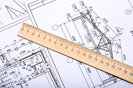 Workplace of architect. Architectural design, sketch, drawing paper, wooden ruler closeup