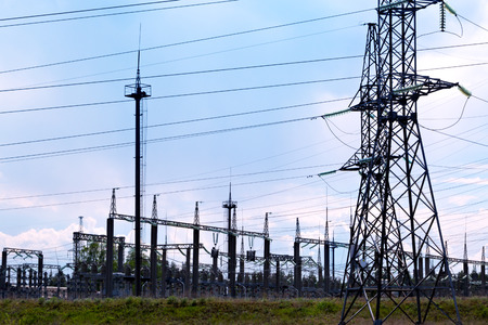 High voltage transmission lines and electric substations with blue sky cloud and forest 스톡 콘텐츠