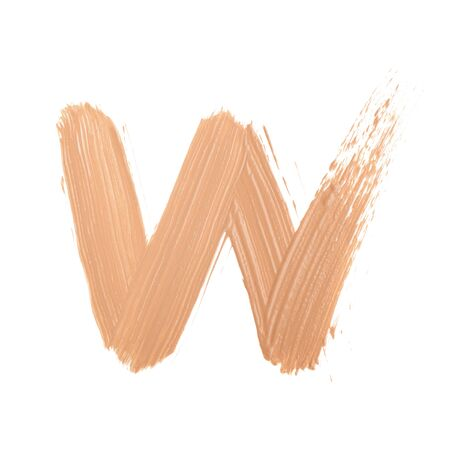 Letter W made with face skin concealer nude color Archivio Fotografico