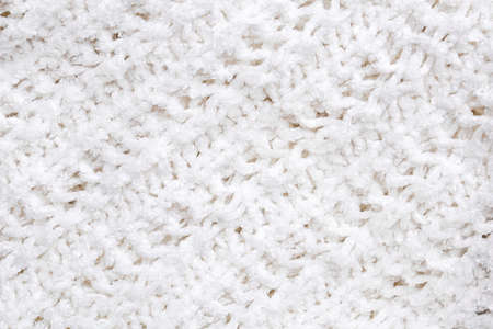 White knitted texture and background, close up.