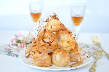 Profiterole, cream puff - French dessert choux pastry ball filled with whipped cream
