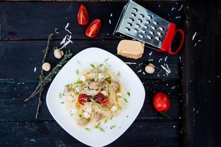 Pasta tagliatelle with tomato, Italian national dish photo