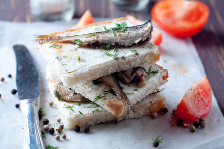 Sandwich, tapas with sardines, sprats with olives and herbs photo