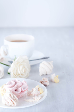 Homemade zefir marshmallows and cup of red tea photo