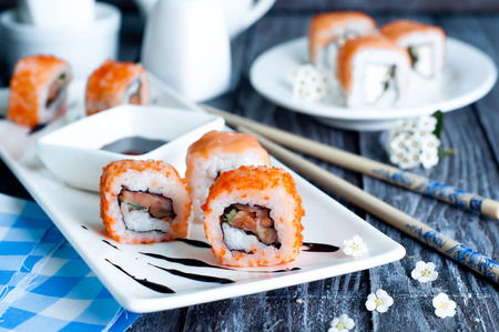 philadelphia roll: Sushi roll on white plate,  California and Philadelphia