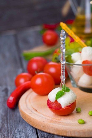 morsel: Delicious appetizer with boccocini, cherry tomatoes and basil or caprese