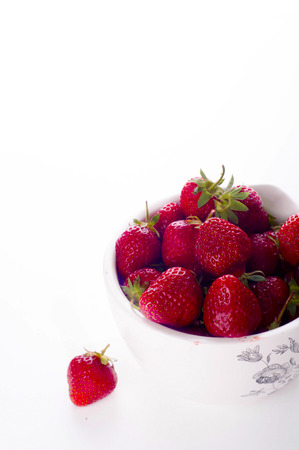 sepals: Strawberries in a Bowl, isolated on white background