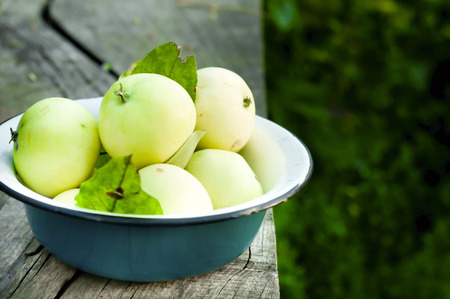 green apples: Bowl of green apples on grey  backgraund Stock Photo