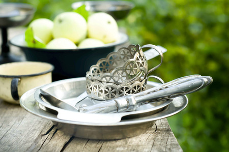 crockery: Many apple fruits over rustic kitchen table with vintage  crockery