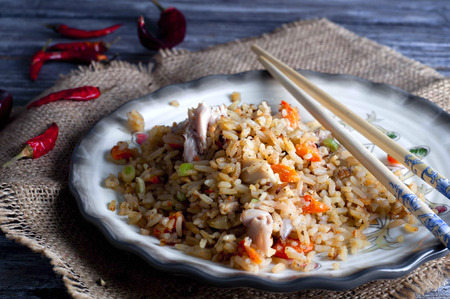 china cuisine: Plate of chicken fried rice with chopsticks on  plate