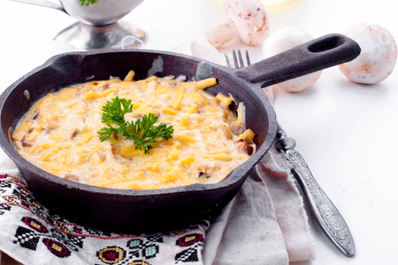 julienne: Julienne with mushrooms, seafood and cream  on the white background Stock Photo