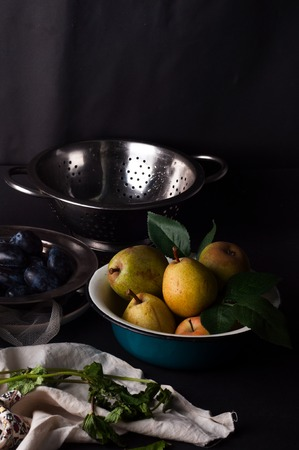 moody: Fresh plums in natural light setting with moody vintage style