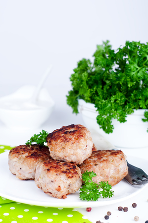 meat sauce: fried meatballs with herbs on white background