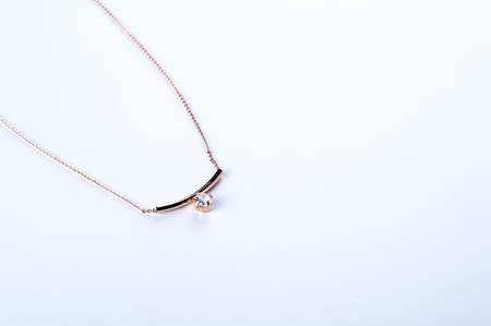 gold necklace with a stone isolated on white background Stock Photo