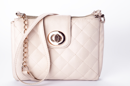 woman handle success: Luxury women quilted bag isolated on bacgraund