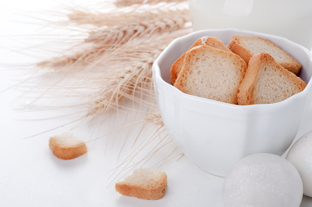 crouton: Crouton stack in a porcelain bowl in white background. Stock Photo