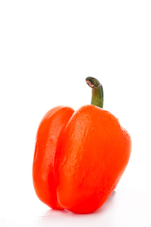 ia: colored pepper ia a white background izolated