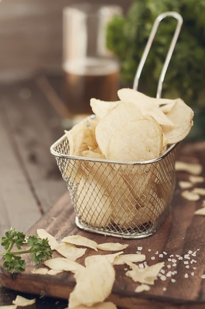 nacho chip: Crispy potato chips  on wooden background, top view .Toned photo Stock Photo