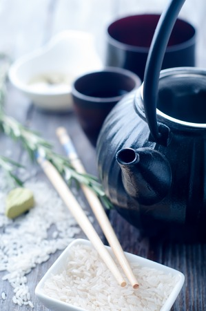 housewares: Chinese black teapot and teacups on backgraund Stock Photo
