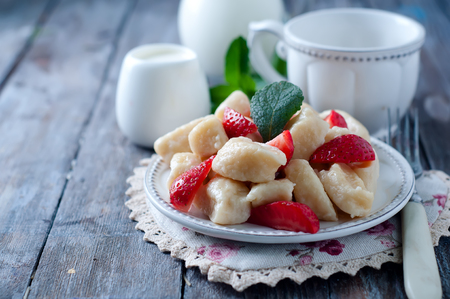 dessert table: Summer dessert lazy dumplings with cottage cheese and strawberries Stock Photo