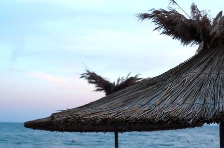 many sun umbrellas in the warm sandy beach of the tourist village Stock Photo