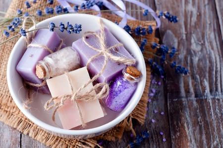 lavander soap with flower on wooden background