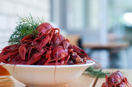 greenery: Boiled crayfishes with greenery on a plate in the table