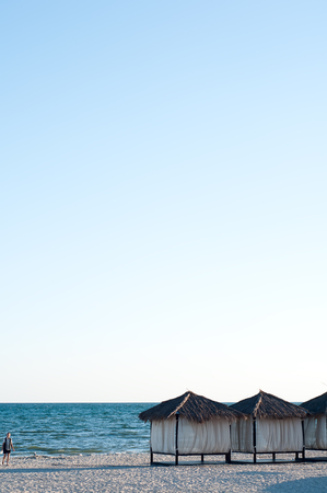 canopies: Canopies with a white cloth on a background of sea and sky. Stock Photo