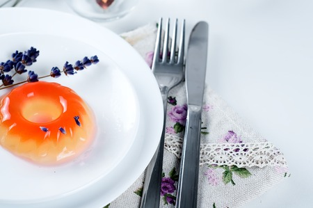 lavander: colorful fruit jelly sweets on a white plate with lavander and tea