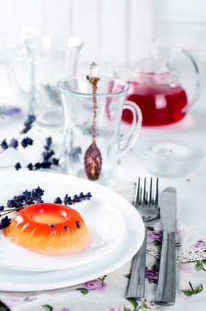 colorful fruit jelly sweets on a white plate with lavander and tea