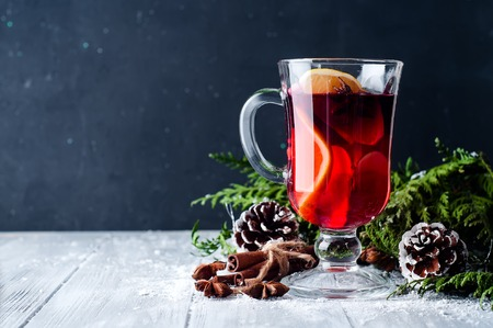 Christmas Mulled wine and spices on wooden background.
