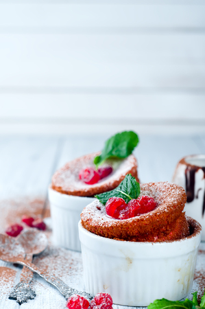 Homemade delicious souffle with dried cherries and mint on a white wooden background Stock Photo